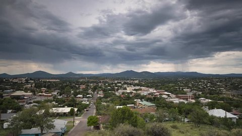 Summer monsoon storms pass over a small mountain town in the desert