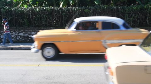 Santa Clara, Cuba-July 20, 2018: Slow motion of a Russian Lada and a car from the 1960s going in opposite direction. Cuba is known for the large diversity of cars from different epoch