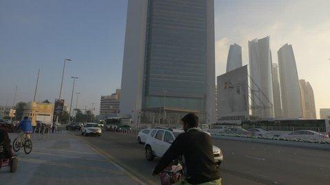 Abu dhabi, united arab emirates - may, 2016: tilt up view of adnoc  headquarters tower in abu dhabi