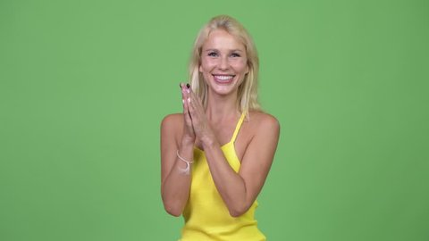 Young happy beautiful blonde woman clapping hands