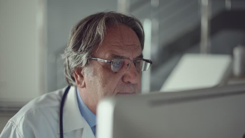 Doctor working with laptop computer | Shutterstock HD Video #1015795624