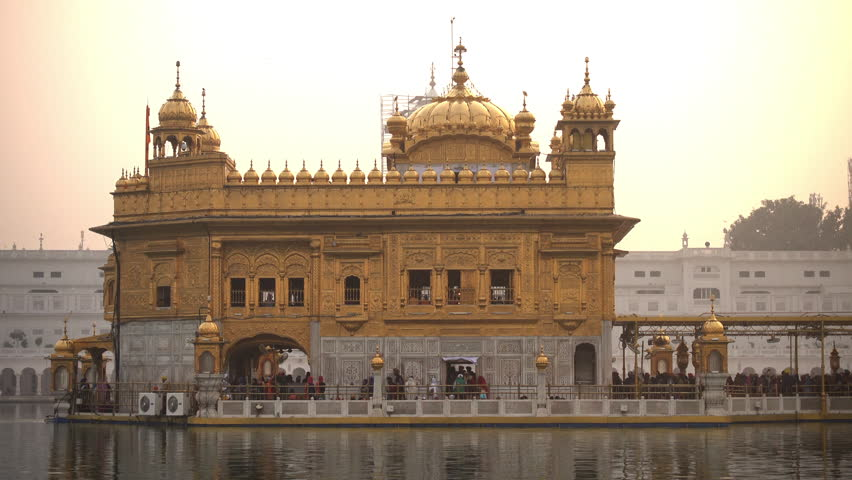 Video of Sikh pilgrims in the Golden Temple at sunset during celebration day in December in Amritsar, Punjab, India. Harmandir Sahib is the holiest pilgrim site for the Sikhs.