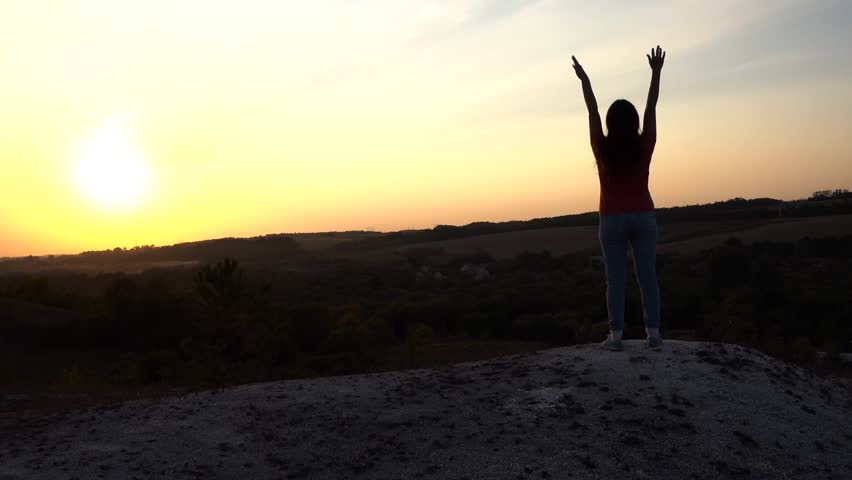 Woman in Success Pose Sunset Hands Up Concept Win and Free.  slow motion, steadicam #1015848304