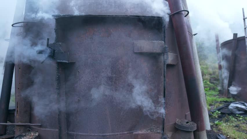 Wood smoking old steel boiler, smokehouse | Shutterstock HD Video #1015865434