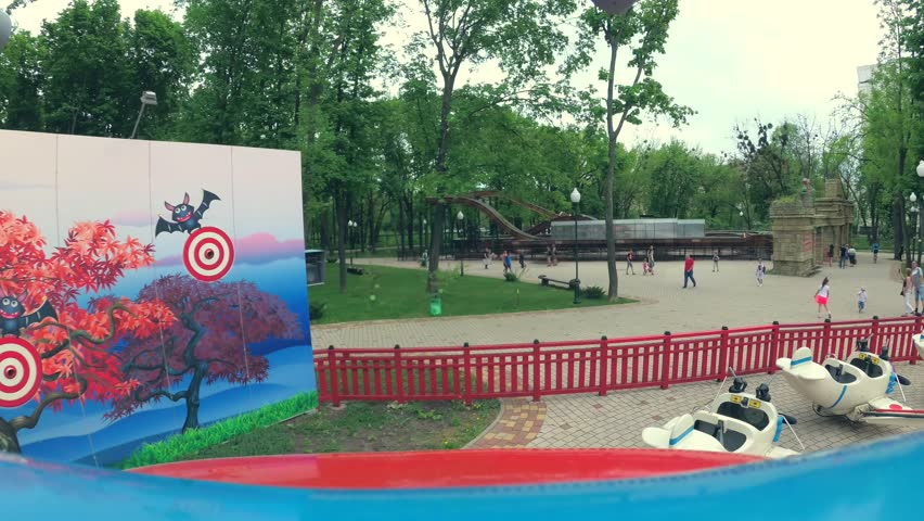 Ukraine, Kharkiv - May 06, 2018: Carousel with japanese planes in park, view from inside