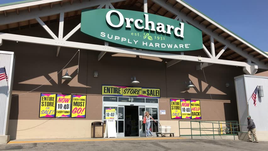 LOS ANGELES, Sep 1, 2018: A truck drives past the entrance to an OSH Orchard Supply Hardware store, which is surrounded with liquidation signs. The chain is set to close for good on October 20th