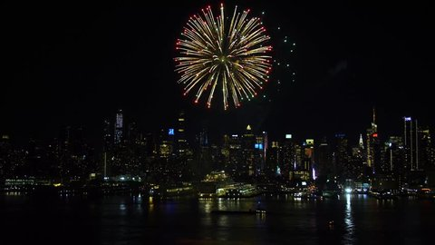 Night shot of upper New York Bay area. Cityscape skyline. Spectacular fireworks. Manhattan