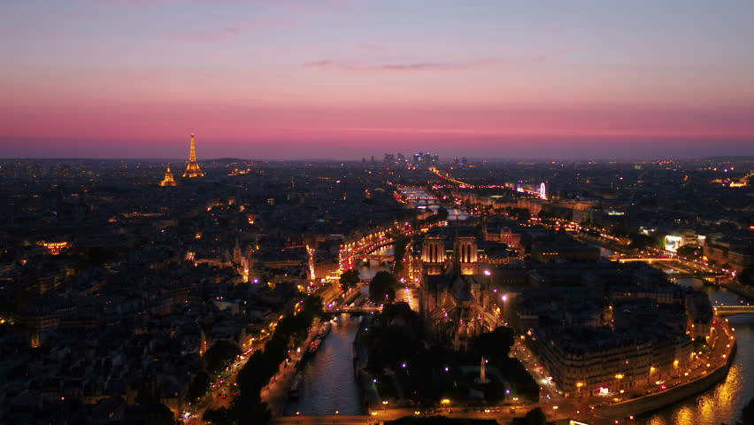 Aerial France Paris Notre Dame Cathedral August 2018 Sunset 30mm 4K Inspire 2 Prores  Aerial video of Notre Dame and La Seine waterfront in Paris France during a beautiful sunset evening. | Shutterstock HD Video #1015904224