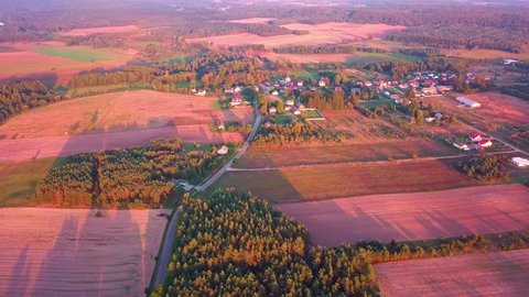 4k AERIAL: Beautiful polish countryside with small village in sunset light. Drone Footage. 3840x2160, 24fps, color graded.