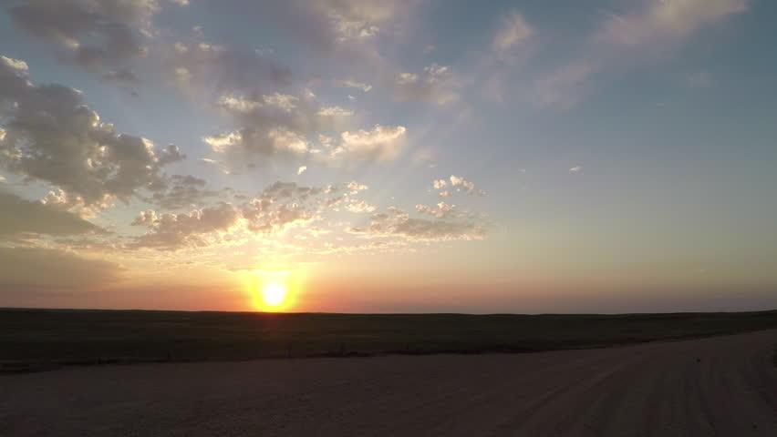 Sunrise Over Dirt Road Along field #1015952464