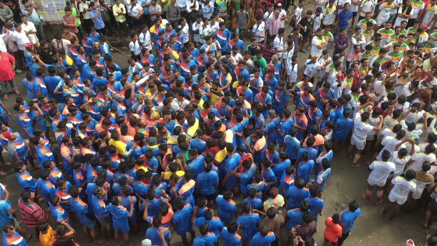 Mumbai /India 03 September 2018 Devotees try to form a human pyramid to break a clay pot during Dahi Handi celebrations at Dadar Mumbai Maharashtra India #1015967284