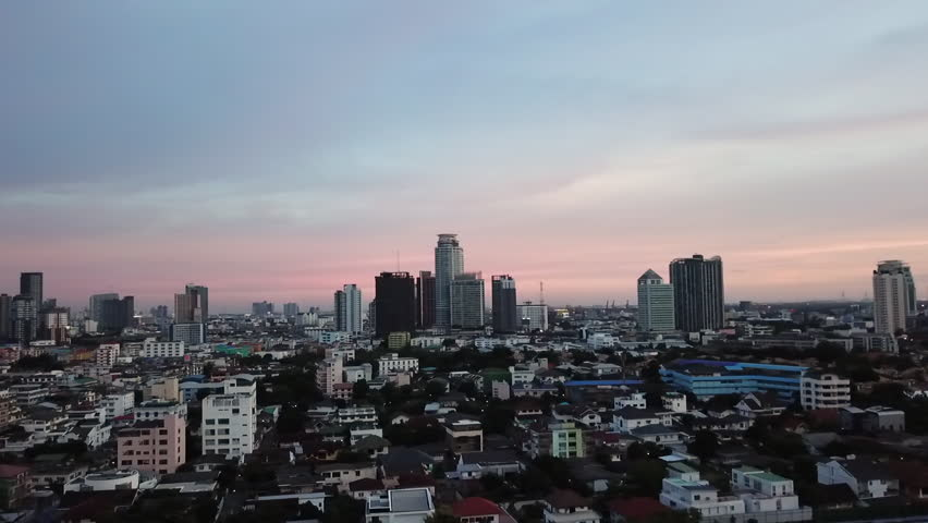 Aerial view of modern city at dawn with pastel coloured sky | Shutterstock HD Video #1015972624