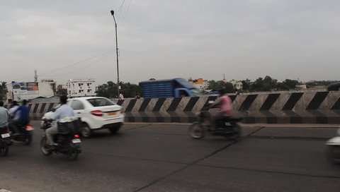 Chennai, tamilnadu / india - 07 21 2018: chennai india july 22 2018 low  light handheld unedited footage of moving vehicles in traffic near  koyambedu bridge