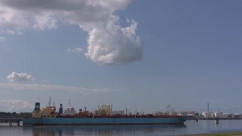 ROTTERDAM SEAPORT - JULY 2018: oil tanker berthed at botlek oil terminal.