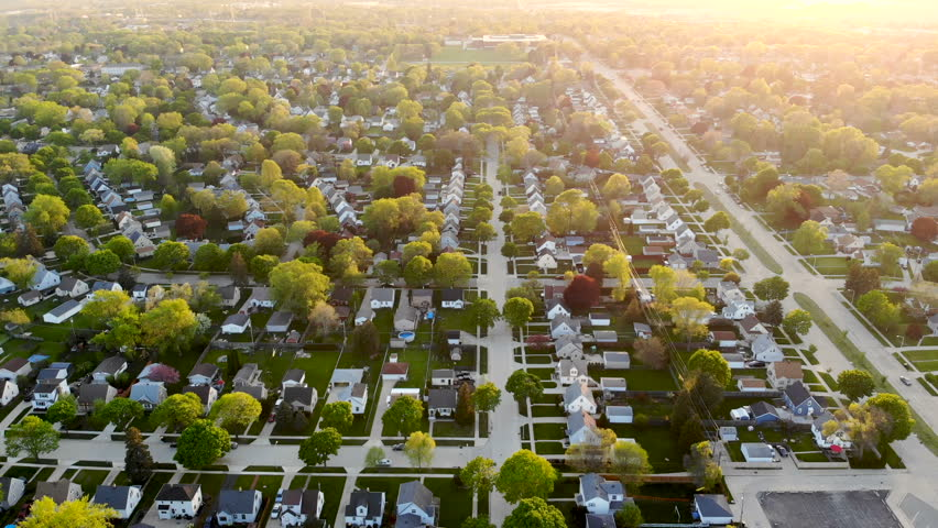 Aerial view of residential houses at spring (may). American neighborhood, suburb.  Real estate, drone shots, sunset, sunlight, from above.  | Shutterstock HD Video #1016048164