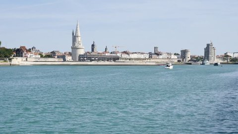 """Cityscape of La Rochelle, a town in western France. The lantern tower (""""Tour de la Lanterne"""" in french), on the left, is one of the towers of the old port."""