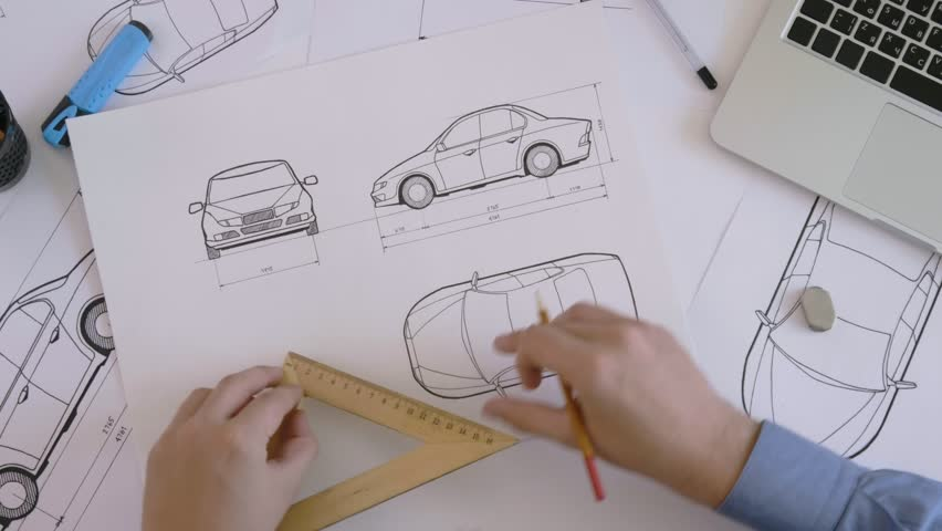 Top view engineer working on a car design sketch
