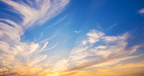 whimsical movements of clouds in the rays of the setting sun