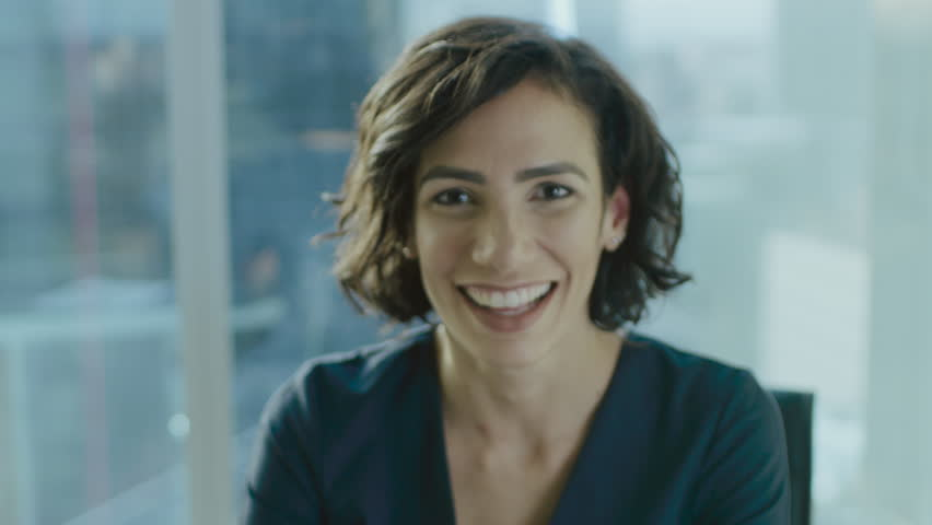Portrait of a Beautiful Hispanic Woman Smiling Charmingly at Camera. Out of Focus Background. Shot on RED EPIC-W 8K Helium Cinema Camera. | Shutterstock HD Video #1016145904