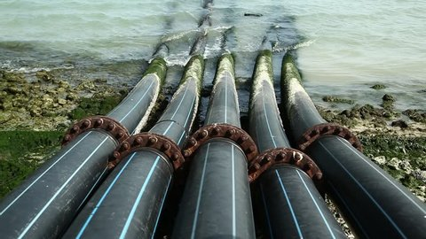 Pipes for intake of sea water and desalination in Doha, Qatar. Desalinization of sea water for city needs, water intake from Persian Gulf, Arabian Peninsula, Middle East