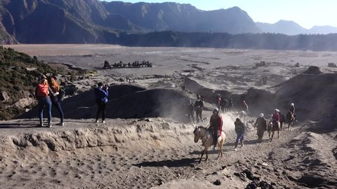 BROMO, INDONESIA - 26 AUGUST, 2018: Unidentified local people or Bromo Horseman at the mountainside of Mount Bromo. Mount Bromo is one of the most visited tourist attractions in East Java, Indonesia.