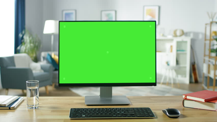 Zoom in On a Modern Personal Computer with Mock-up Green Screen Display Standing on the Desk of the Cozy Home Office. Shot on RED EPIC-W 8K Helium Cinema Camera. | Shutterstock HD Video #1016261914