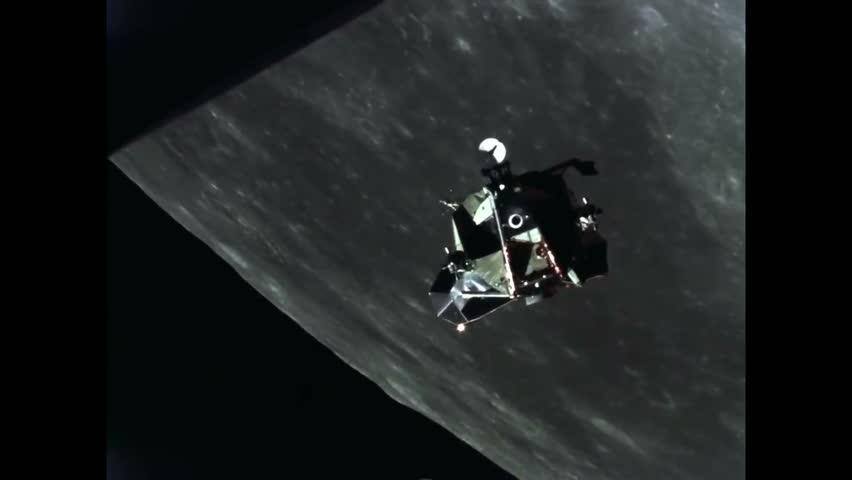 CIRCA 1969 - A camera on Apollo 11 films a satellite near it in lunar orbit.