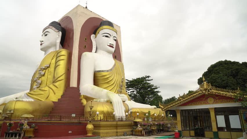 Four Faces of Buddha at Kyaikpun Buddha, in Bago, Myanmar, in the rainy season
