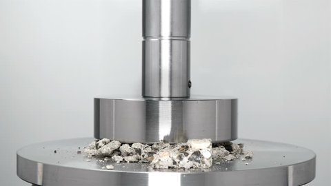 restoration of a block of cement and stone after destruction by hydraulic press, rewind, close-up