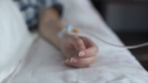 In the hospital. Close-up of a woman's hand with a catheter