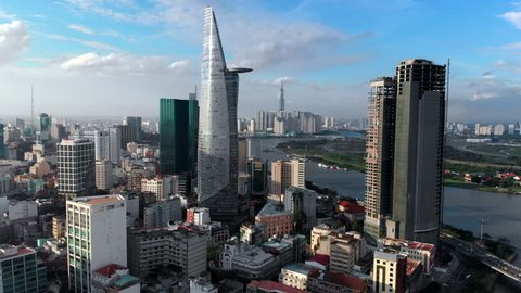 Aerial view of Downtown district of Ho Chi Minh City, aka Saigon, including architectural landmark Bitexco Financial Tower during daytime, South Vietnam.