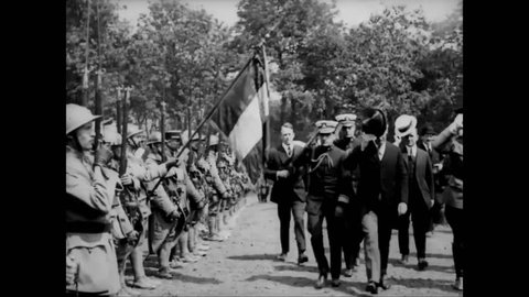 CIRCA 1919 - President Wilson, Admiral Grayson, and Marshal Foch arrive at a military cemetery in Suresnes, France.