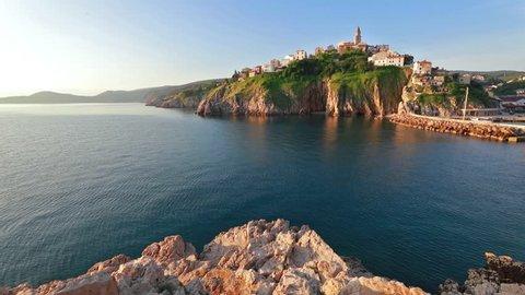 Exciting morning cityscape of Vrbnik town. Splendid summer seascape of Adriatic sea, Krk island, Kvarner bay archipelago, Croatia, Europe. Full HD video (High Definition).