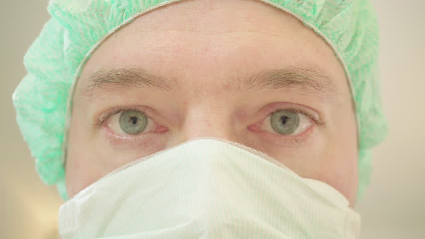 A surgeon with green eyes, close-up view | Shutterstock HD Video #1016450074