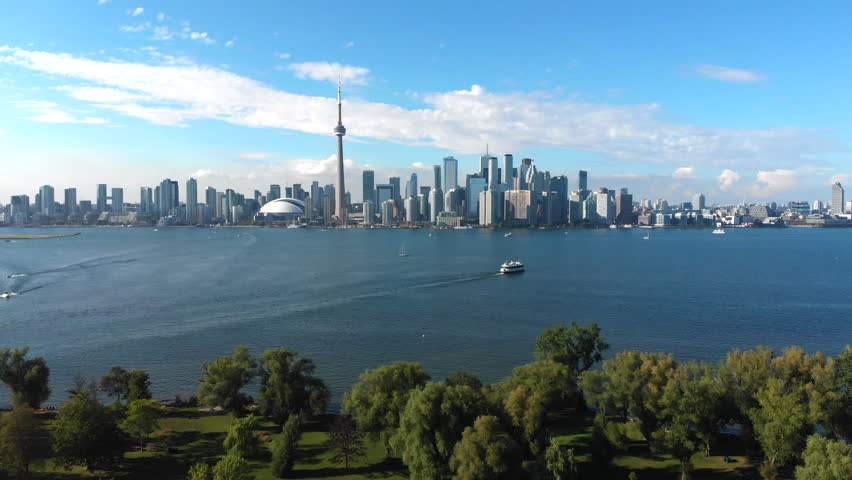 Aerial view of Toronto skyline, Centre Island and Lake Ontario on a summer day in Toronto, Ontario, Canada, tilt up.