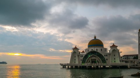 4K time lapse of sunset moments at Malacca Straits Mosque ( Masjid Selat Melaka). It is a mosque located on the man-made Malacca Island near Malacca Town, Malaysia