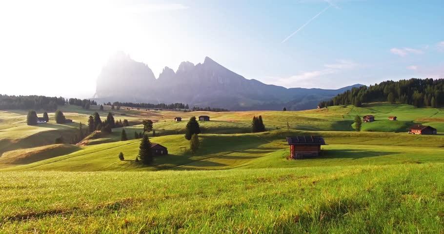 Colorful morning scene of Compaccio village with Sassolungo / Langkofel peak on background, Seiser Alm or Alpe di Siusi location, Dolomiti Alps, Italy, Europe. 4K video (Ultra High Definition). | Shutterstock HD Video #1016554654
