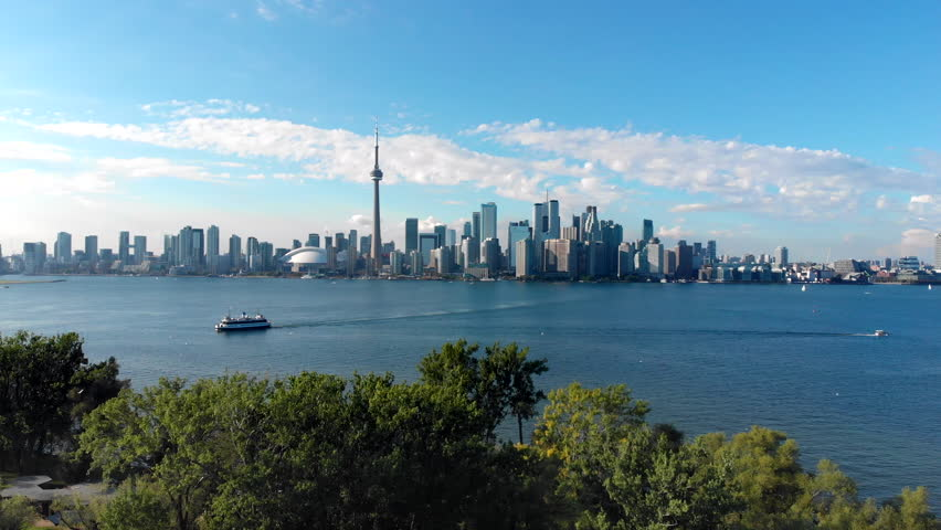 Aerial view of Toronto skyline, Centre Island and Lake Ontario during summer in Toronto, Ontario, Canada. | Shutterstock HD Video #1016565694