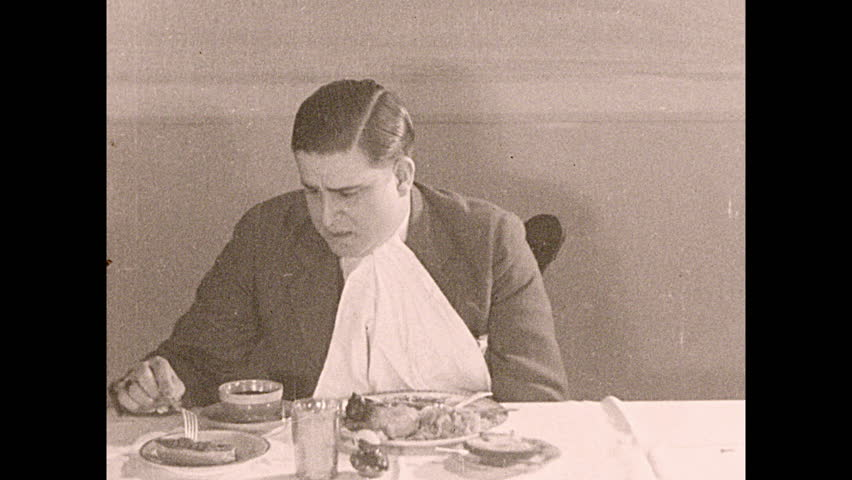 1930s: Man at Dinner Table, Stock Footage Video (100% Royalty-free)  1016566804 | Shutterstock
