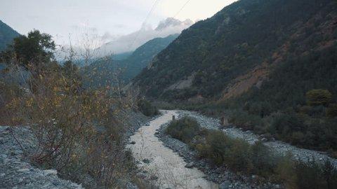 Along the river mountains
