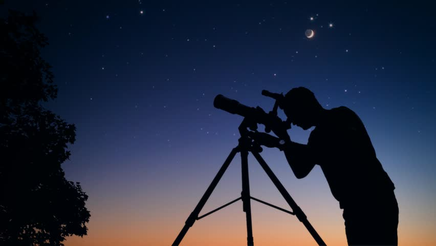 Man looking at stars and Moon through a telescope. My astronomy work. | Shutterstock HD Video #1016603194