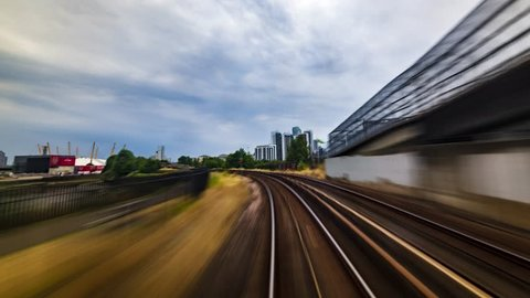 Timelapse of the Docklands in London in motion from a fast moving train, POV hyperlapse