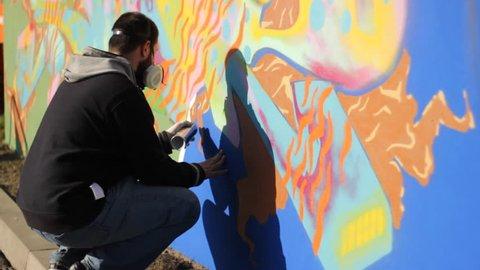 Gangsta Wall Street Art ,Graffiti wall Artist spraying