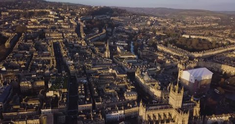 Aerial footage of city of bath with beautiful golden hour light from sunset