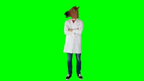 Doctor Standing with Crossed Arms on Green Screen Nods Head in Horse Head Mask