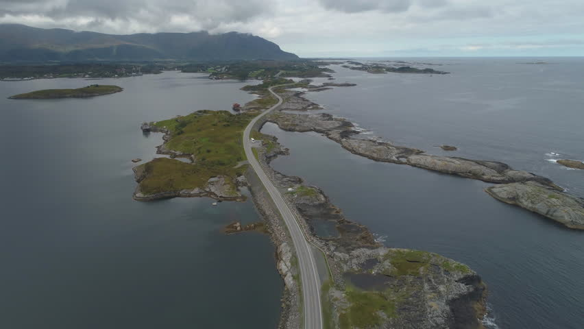 Atlantic Ocean Road in Norway. Aerial View from High Altitude. Drone is Flying Forward, Camera is Tilting Up