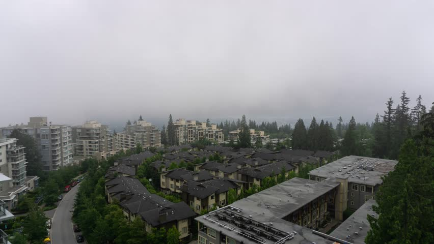 Aerial timelapse of a residential neighborhood during a cloudy summer day. Taken on top of Burnaby Mountain, Vancouver, BC, Canada.