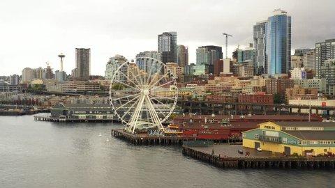 SEATTLE, WASHINGTON, USA - SEPTEMBER 15, 2018: Aerial low video Seattle Great Wheel 4k 30p