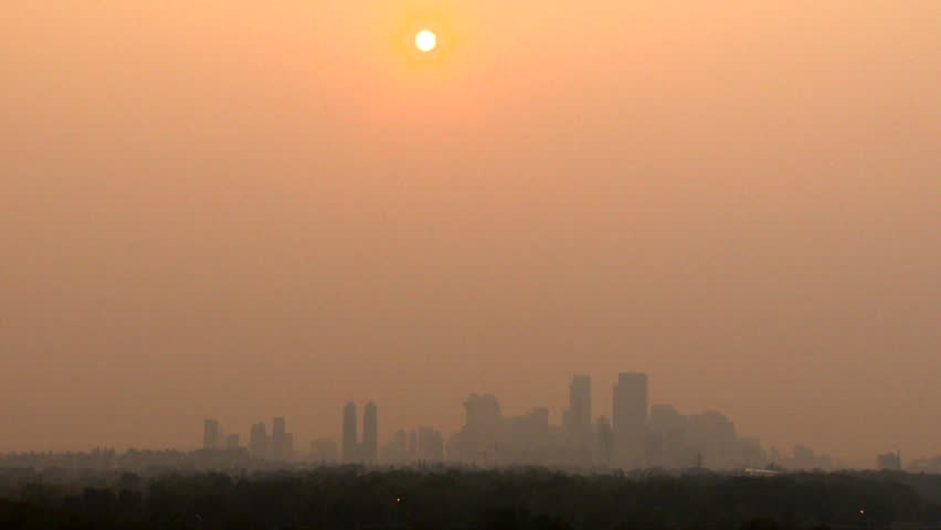 Wildfire smoke covers downtown Calgary, Alberta, Canada. Red sky hours before sunset. | Shutterstock HD Video #1016783464