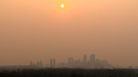 Wildfire smoke covers downtown Calgary, Alberta, Canada. Red sky hours before sunset.